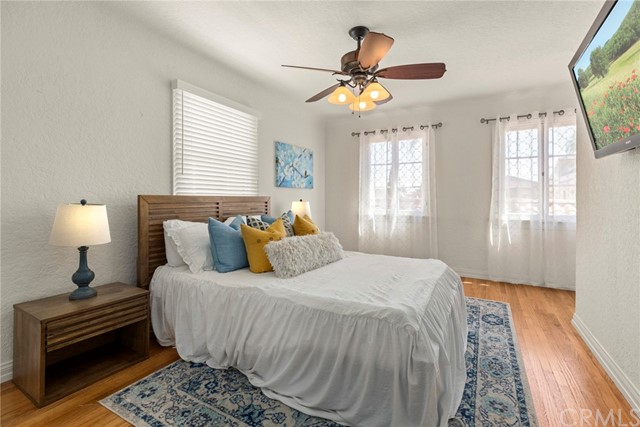 Upstairs secondary bedroom #1...a light & bright room with plenty of space and beautiful hardwood floors...