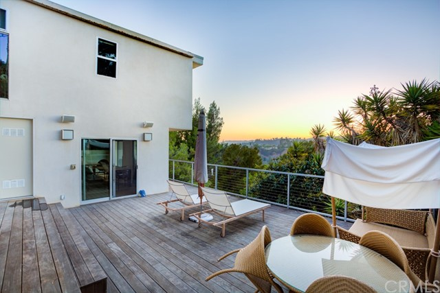 BUY THIS HOME AND TRADE! Stunning designer home in Beverly Hills 90210! This gorgeous, fully renovated home is located in a quiet cul-de-sac with phenomenal views! The entire property is custom designed by Gerhard Heusch Architecture & Wick Architecture, with design and project management by James Devens NYC. The home features a custom open floor plan with a Bulthaup kitchen, Ceaserstone counters, and a Gaggenau cooktop. The kitchen includes a SubZero fridge and freezer, Miele dishwasher, and Franke stainless steel sink with faucet. The main living room boasts a gas fireplace with custom hardwood floors and woodwork by Zook Woodworking. The luxurious master bedroom with walk-in closet also has a steam shower and towel warmer. The outdoor living area is like having your own private oasis with a built-in grill and fridge on the island counter, perfect for entertaining. Just minutes away from the Beverly Hills Flats and Rodeo Dr. for convenient commuting and shopping. This amazing home is move-in ready! Disclaimer: Tax data shows 3 bedrooms, home has an additional room that may be converted into a 4th bedroom. All information deemed reliable but not guaranteed.