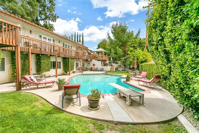 Price reduction 9/10/2020- Check out the view of this Raymond Hills beauty.  Views to Disneyland and Catalina and over looking your beautiful magical backyard with refreshing pool, just in time for summer. The backyard with many layers has several places for you to entertain, fruit trees, secret fairy hiding places, built-in bar, and access to the game room downstairs for oodles of fun to be had.  The upstairs TREX deck covers the entire span of the home and allows you and your guest to interact from upstairs to the backyard.  Ohhh, imagine the fun to be had for years in this home.  Inside, the home has recently been rehabbed with new waterproof laminate, fresh paint, smooth ceilings, new carpet, some of the many bathrooms have been recently remodeled.  Features of the home include : almost every bedroom has an attached bathroom, large individual laundry room, 3 car garage, 3 fireplaces, crystal chandeliers, Sub-Zero fridge in kitchen, large walk-in closet in master bedroom, huge fun game/family room downstairs off backyard, and intricate water features in the front yard.  All these features in 6 bedrooms, 7 bathrooms, 5200 sq/ft living space and located in the very desirable Beechwood Elementary boundaries K-8 school and prestigious Raymond Hills.  Don't wait to make your appointment as this one will sell fast.  Buyers must check out this 3d tour before making appointment:  https://my.matterport.com/show/?m=hxAcstVYEUh&mls=1
