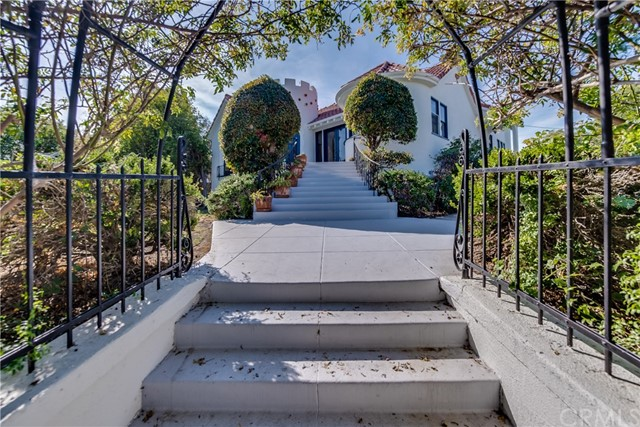 """What creates value...Scarcity, rarity, quality. You will find that here in this beautifully remodeled Old Spanish Home.  Spanish Revival homes were built between 1915 and 1940; this 1929 home epitomizes the best qualities of this architectural style; archways and alcoves, Moorish turret, full on sun lit walkout basement for kids or media room or (you choose) and 3 car garage.  Gorgeous hardwood floors. Infrastructure elements and kitchen remodeled in last 5 years at huge expense to current owner.  Kitchen notes: The quartzite on the island is """"Taj Mahal"""", the blue stone is Lava Stone and the Viking range also has gridle.  And top this all off with the fact that the property sits high on the street on top of a flat, fruit tree filled, large play yard lawn  DOUBLE LOT.  Water and city views add to the value package.  Make this your home today"""