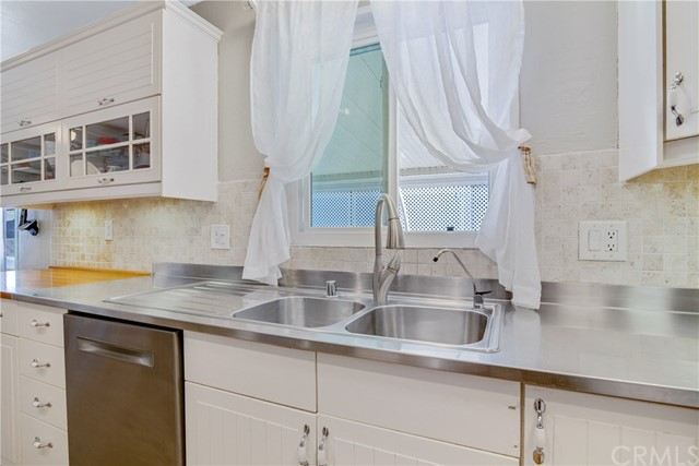 Double stainless steel sink with updated fixtures