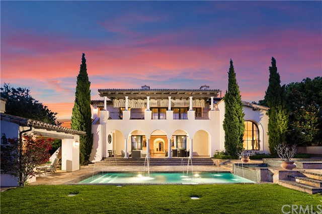 Ideally located in the upscale community of Shady Canyon, surrounded by lush foliage and immaculate grounds, step inside this palatial nearly 14,000 SF estate. The home is remarkable, showcasing three levels of interior living space on ¾ acres of land. The home is chic, sophisticated and timeless in décor, offering 5 en suite bedrooms, including a gorgeous master retreat with stellar views and a private balcony. The property is within minutes of Irvine's open space, hiking trails, golf, and Irvine's top-rated schools. The home features a chef's kitchen with top of the line stainless appliances, a theater, gym, wine room, game/bar/rec room, and a resort style backyard with a tranquil pool and spa, overlooking the gorgeous canyon. This immense home is nestled among beautiful tree-lined streets in the exclusive and private guard gated community. The property boasts intricate design features and elements including coffered ceilings, lighting, wrought iron, custom built-ins, imported stone, wood floors and so much more.