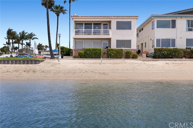 """Prestigious Lido Isle in Newport Harbor is the location of this rare bayfront triplex property on a 40' wide lot. All of the fun of Newport Beach is out your door, swimming, sailing, bike riding, paddle boarding, and the newly updated Lido Village with its fine dining and high-end retail shops are an easy walk away. Lido Isle is the ultimate waterfront lifestyle community with its private Beach Club, summertime snack bar, parks, tennis courts, stradas and activities for the entire family including sailing and tennis instruction. Offered for sale for the first time in over 45 years, the property has spectacular waterfront vistas of the harbor, sits on a pristine sandy bay beach and all three units are flooded with natural light due to its corner location on the Lido Isle """"boat garden"""" and sunny southern exposure. Unit A is a bayfront three bedroom, three bath, 1,567 sqft, with a waterfront patio and leases at $5,880 per month, unit B is an upstairs bayfront unit with two bedrooms, two baths, 1,491 sqft, and a waterside deck that leases at $4,388 per month, and unit C is a two bedroom, one and one-half bath, 862 sqft, unit over the garage that has waterfront vistas and leases at $2,500 per month. Come enjoy the Lido lifestyle."""