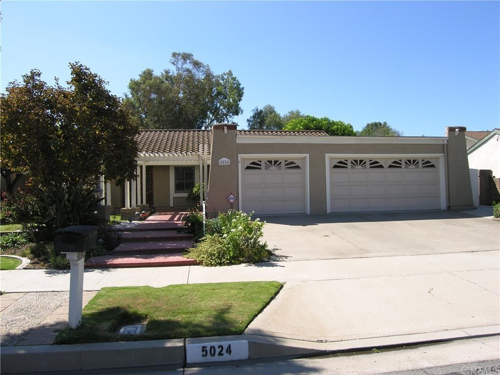 Dramatic and roomy 3 bedroom, 2 Bath single level custom built home featuring a very large family/bonus room off the rear with a large dramatic fireplace and double sliding doors to a large covered patio. Spacious and private large rear yard with plenty of space of the avid gardener.  A fully equipped gourmet kitchen features gas range, granite counters, oven and microwave, dishwasher, sit down dining counter and low maintenance tile floors. Also featuring a formal living room w/fireplace and formal dining room. Also included are a 3 car garage(1 smaller) and separate laundry room.  Further amenities include central air conditioning, automatic sprinklers, ceiling fans, newer dual pane windows, gorgeous wood floors and much more.  Includes newer paint and carpets.
