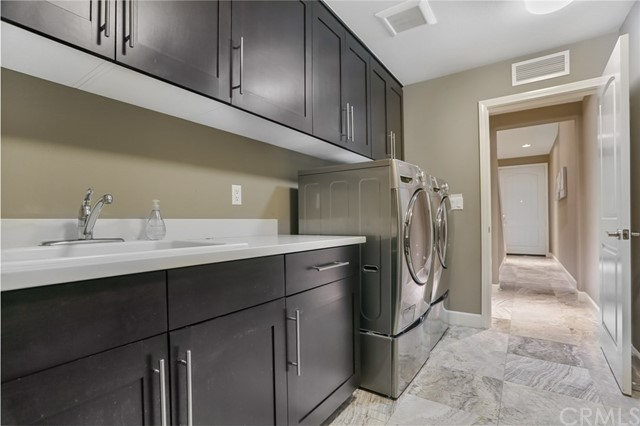 Laundry Room with Sink and Travertine Floor