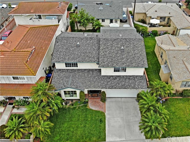Spacious 4 bedroom, 3 bath home in the heart of Downey.  Features a living room and family room, nice master bedroom, and a yard with covered patio.  The home has been tastefully remodeled through out.  A great house near the Downey Landing, downtown Downey, and the new Downey Promenade.
