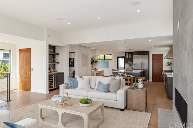 3 stop elevator leads to the grand open living area (shown here using reverse of 961 Unit A staging)