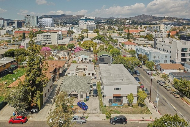 There are two parcel next each other: 5807 Virginia Ave, Los Angeles, CA 90038-2005 with the APN#:5534-018-011 with lot size of 7500. sqft. has 3 units and 1163 N Van Ness Avenue has 6 units combined both lot for the total of 9 units, 7746 Living Sqft & 14,961 Sqft Lots. Properties must be sold together, the combined land comes out to 14,961 square feet. This is a rare opportunity to find side by side lots on a corner. Buyer/Developer must confirm with the city of Los Angeles to determine the maximum number of units that can be built.