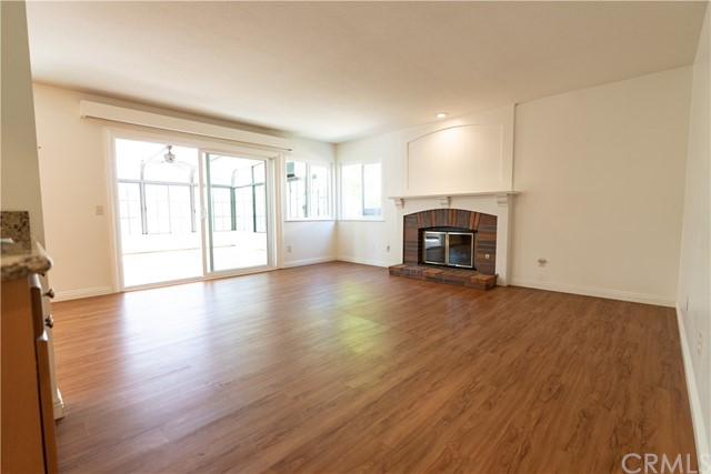 Family Room with fireplace and wet bar - sliding doors to Sunroom