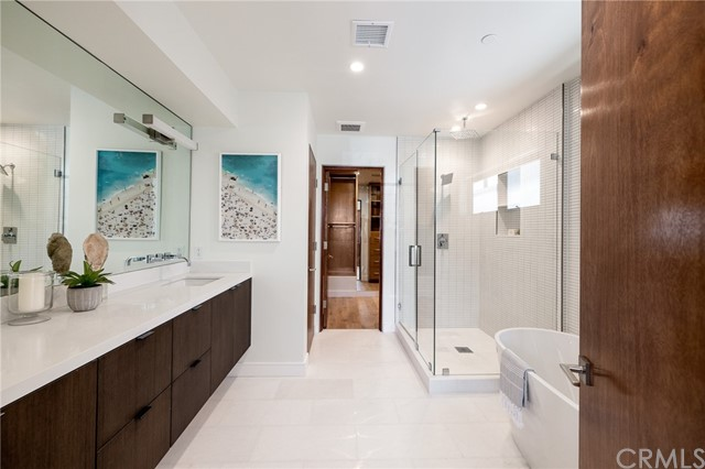 Spa like master bath with deluxe soaking tub, walk in shower, premium fixtures and custom cabinetry