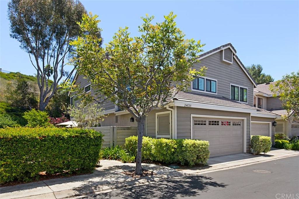 OCEAN CLOSE LAGUNA NIGUEL END UNIT ATTACHED HOME ON ONE SIDE ONLY WITH A HUGE WRAP-AROUND YARD THAT LOOKS OUT AT OPEN SPACE WITH NOBODY LIVING RIGHT BEHIND YOU WHICH GIVES YOU ADDED PEACE AND QUITE ALONG WITH SOME PRIVACY. THE LARGEST FLOORPLAN IN THE TRACT FEATURING, APPROXIMATELY  1500+ SQUARE FEET OF LIVING SPACE REPLETE WITH 3 BEDROOMS, 2.50 BATHS, SEPARATE LIVING ROOM WITH VAULTED CEILINGS AND A FIREPLACE,FAMILY ROOM THAT OPENS UP TO THE KITCHEN,BOTH THE FAMILY ROOM AND THE LIVING ROOM HAVE A DOOR TO THE OUTSIDE LIVING AREA/YARD WHICH MAKES ENTERTAINING EASY PLUS A 2 CAR ATTACHED GARAGE WITH DIRECT ACCESS FROM THE KITCHEN AREA. THE PROPERTY HAS BEEN PAMPERED BY THE CURRENT OWNER AND HAS MANY UPGRADES THAT MAKE IT STAND OUT OVER THE OTHERS IN THE COMMUNITY IN ADDITION TO BE BEING AN END UNIT WITH A LARGE YARD IT HAS NEWER DOUBLE PANE WINDOWS/SLIDER DOOR THAT MATCH THE EXTERIOR WITH A INNER WHITE FRAME FOR THE INTERIOR, ALSO A NEWER FRENCH DOOR THAT GOES FROM THE KITCHEN AREA TO THE OUTSIDE YARD,NEWER HVAC SYSTEM,NEWER HARD SURFACE FLOORING & CARPETING,UPGRADED LIGHTING FIXTURES,NEWER KITCHEN REFRESH WITH STAINLESS STEEL APPLIANCES,GRANITE COUNTER-TOPS AND AN UPDATED HALLWAY BATHROOM & POWDER ROOM,PLANTATION SHUTTERS,ROLL UP GARAGE DOOR WITH WINDOWS,SOME CROWN MOULDINGS,NEWER SINK FAUCETS. THIS IS PRETTY MUCH IN TURN-KEY CONDITION FOR COMFORTABLE LIVING IN LAGUNA NIGUEL.