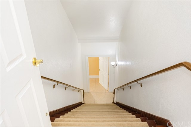 Staircase to the separate home located on the lower level.