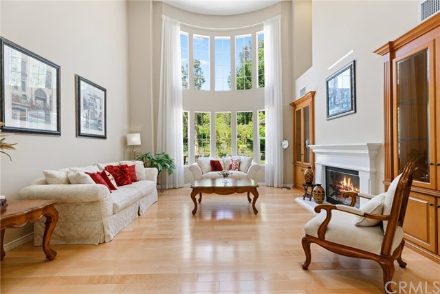 Fabulous residence with unique and desirable dual master suite floorplan.  Bask in the sun in your own private resort-like grounds, listen to soothing waterfall tones from the oversized spa, grill a tasty meal for family and friends, and enjoy the peace and serenity that surrounds you. Impressive interior amenities include sprawling open floorplan and the bonus of a desirable downstairs master suite with sumptuous bath and private backyard access. Gorgeous floor to ceiling windows capture your attention as you enter the formal areas. Your gourmet granite kitchen, with stainless steel appliances, lies adjacent to the generous family room with fireplace flanked by custom built-ins. An additional downstairs oversized en-suite bedroom with retreat area is ideal for a secondary master, guest quarters or home office needs. The downstairs is complete with lovely powder bath and an amazing oversized utility room with abundant storage that makes this a perfect additional space for craft room needs.  Ascend the staircase to the three additional bedrooms, two en-suite with gorgeous upgraded bathrooms. A built-in tech center at the top of the stairs is perfectly suited for convenient homework station. Just a short stroll to amazing hiking trails through the hills. Situated in the prestigious Summit Pointe guard gated neighborhood, you will discover executive living at its best.