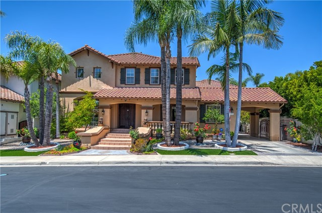 Welcome to 12185 Glines Court, in a highly coveted Guard Gated Tustin Ranch Community.  Neutral toned marble floors and the dramatic foyer welcome guests.  The formal sitting room is picturesque with abundant windows.  The space opens out to the formal dining area where guests can be entertained.  The open concept great room with fireplace is adjoined by the chef's kitchen.  The kitchen is nicely designed with an oversized center island, tons of counter space, built-in desk, walk-in pantry, and a wet bar/beverage center.  The main floor is highlighted with a main floor suite that is complete with a private porch area.  The main floor bedroom was nicely converted from the 3rd car garage.  The space is joined with a separated space that can be harmoniously used with the bedroom or separately for a home office.  On the second level you will escape to the well appointed bedrooms, a loft area, and an additional space with options for an office or a work out space.  The grand master suite is accented with trayed ceilings and abundant windows.  The master bath is lavish in detail and functional.  Dual vanities, oversized soaking tub and a huge shower is all nicely done with extensive stone work.  A large walk-in closet and a beverage sink area completes this suite!  One of the secondary bedrooms boasts an in suite bathroom.  French doors lead you out to a private balcony to enjoy fresh air.  Plenty of elegant details in the home including, upgraded flooring, plantation shutters, and lots of versatile built-in's.  The backyard is easy to maintain with a tropical feel and nice planters.  Summers will be nice for having outdoor parties in the covered patio while enjoying the peaceful fountain.  Great curb appeal with an oversized private driveway with space for several cars.  Award-winning schools, Close to Tustin Market Place, parks, trails, and golf are all minutes away.