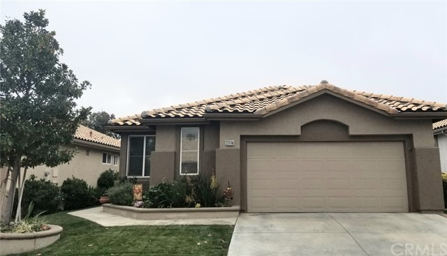 """YOU'RE GOING TO LOVE THIS ONE!! Nicely decorated and lots of upgrades has this Sun Lakes Country Club golf course home MOVE IN READY!  This popular """"Columbine"""" model is 1474 sqft. with 2 bd, 2 ba plus an office/den.  As soon as you enter you'll see the beautiful wood look of the vinyl plank flooring that's throughout the home.  The custom, stacked stone surround for the fireplace is the focal point of the living room, and then your eyes are drawn to the beautiful view of hole #16 of the Executive Course.  Its positioned with views of the lake, mtn, Tee box & green, all the while of being under a full length patio cover. More on the inside, you'll love the clean look of the kitchen with it's custom white cabinets, white tile counters and newer stainless appliances. There are convenient slide out drawers, a custom pantry was added and a nice breakfast bar.  Both bathrooms have also been remodeled with beautiful  quartz counters, new sinks and fixtures.  The 2 bedrooms are on opposite ends of the home (a nice feature).  The Main bedroom is good sized, with a walk-in closet and a slider to the back patio for your convenience & great views.  An Indoor Laundry is a bonus.  The garage has 16ft of custom overhead storage racks and a separate area for golf cart parking.  A few of the other upgrades are 5""""custom baseboards throughout,  ceiling fan/lights in most rooms,   a """"WEMO"""" smart light switch controlled by a phone app,  exterior sun screens on some windows  and vinyl fencing.  This home even comes with some great neighbors that the Sellers say they've really enjoyed.   Nice home, Nice location, Nice neighbors ! This really is a MUST SEE! Sun Lakes Country Club has two golf courses, three clubhouses (one with a full service  restaurant and lounge), three swimming pools (one indoors), three exercise gyms, tennis, pickleball, pop tennis, bocce courts, many social clubs and a gated RV storage. Excellent shopping , restaurants, and medical facilities are close by,  NO MELLO """