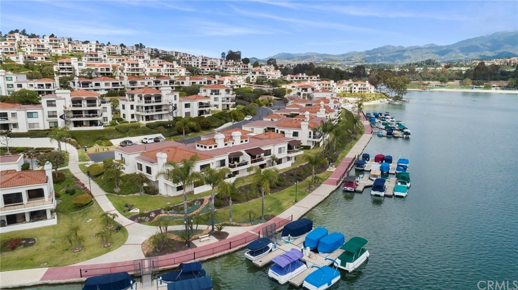 The absolute Jewel of the exclusive lakeside Mallorca Community. This is a once in a lifetime opportunity. First time on the market in almost 30 years.This is the largest model with the absolute best Waterfront location. Incredible Unobstructed Panoramic Lake Views from almost every window and located at the end of a cul de sac with extra guest parking, lake access and private boat docks just steps away. Premium 3 bedroom 2.5 bath end-unit with a large open and airy floor plan. Enjoy single level living with Living Room, Dining Room, Kitchen, Powder Room and best of all the Master bedroom and bath all on the main level. The lower level has a very spacious Guest Bedroom and full bath and a double door entrance to the third bedroom/office with sliding door for full lake views. Enjoy all of what this special community has to offer with Lake Activities, Summer Concerts, Sandy Beach, Picnic/BBQ area and Pool and Spa. The Mallorca Community offers a 24/7 live gate attendant.