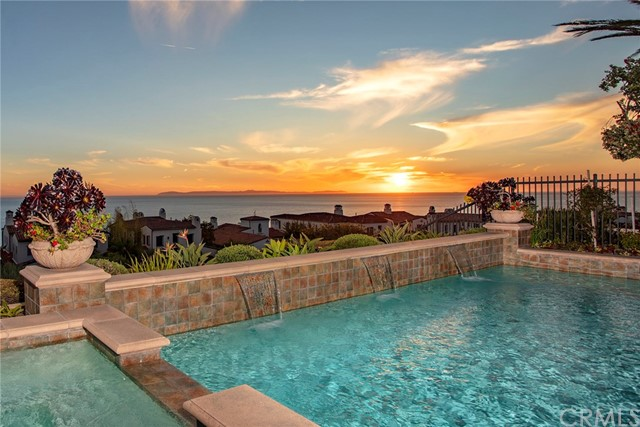 RARE SINGLE LEVEL WITH VIEWS……..Nestled behind the gates of Newport Coast's coveted private community, Crystal Cove, this extremely rare single level seaside estate represents value and craftsmanship around every corner with upgrades featured throughout. Located on a quiet cul-de-sac the 4-bedroom suite 4.5 bath home offers 180-degree coastal views with year-round sunsets and Catalina resting in the backdrop. The gracious master retreat offers a spa like bath, oversized walk in closet, and ocean facing French doors that lead you to a covered loggia with a fireplace. The fourth bedroom suite (which was a rare option on this model) has an attached office/bonus room, with two private external entrances.  In addition to the finely appointed bedroom suites the property boasts Viking Clad chefs' kitchen, formal and informal living spaces, formal dining room and resort like grounds. The exterior reflects the best southern California coastal living has to offer with pool and spa, water features, fireplace, Built in BBQ station, exquisite hardscapes, lush landscaping, and endless views.