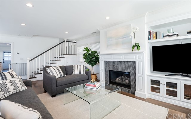 """Rare, warm, contemporary remodeled home located on a corner lot with amazing ocean view roof deck.  A privacy hedge & new white fence greets you as you walk through the child friendly front yard. Open the door to this happy & graceful 3 bed, 3 bath home w/ ~ 2000 sq ft.  Custom floors & A+ upgrades (AC!) are part of the """"WOW"""" factor!  The living room features an inviting window seat, a refaced fireplace & a wall of large windows for amazing natural light.  The dining area focal point is a large drop down pendant hovering over a farm table.  The kitchen w/ all newer appliances has a huge walk in pantry, breakfast bar & opens to a new custom-built office/study space, w/ a Dutch door to a back patio, w/ grill & built-in casual bench seating.  One bed & remodeled bath are on the lower level.  Upstairs  features a large master suite w/ vaulted ceilings, window seat, refaced fireplace, walk-in closet & gorgeous remodeled bath, both with ocean peeks. Upstairs laundry room has ample linen storage. The third bedroom is large w/ vaulted ceilings & ocean peek. Another flight up is an amazing roof deck w/ a new glass protective perimeter.  Choose the bar stool perch or the built-in couches to photograph your favorite sunset.  The detached garage is located on 20th place w/a side storage area. Side street parking & back home entrance are key on this corner lot.  This family friendly neighborhood is a few blocks to schools, parks, dining, shopping & only a 10 min walk to Hermosa Pier."""