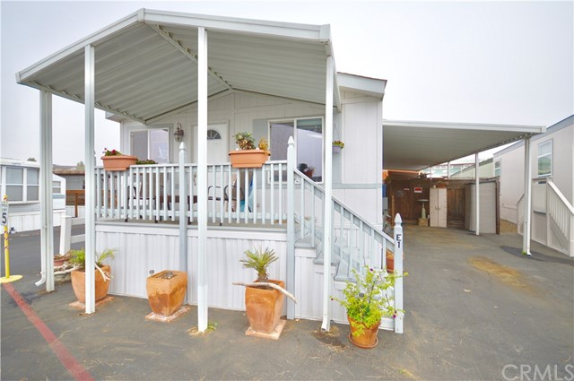 This newer double-wide mobile home is located in a terrific location within Silver City Mobile Home Park, which is just a short distance to the beach!  It sits on a large corner space with a view from the front balcony down the street and to Morro Rock, rather than at other mobile homes.  There is also a large covered private patio area with a hot tub and enough driveway space to fit two vehicles.  Inside is a bright and open floor-plan with a laundry room a master suite, and guest room and bathroom.  This is a 55+ park.