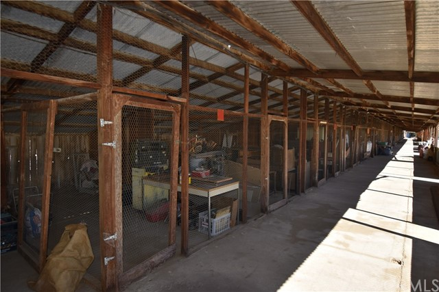 Used for poultry ranching at one time.  Concrete flooring, brick and wood structure plus steel roofing