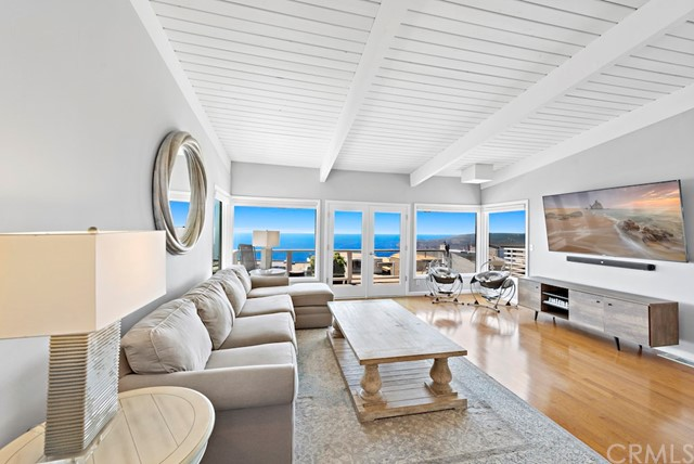 Main floor living room and kitchen feature expansive ocean, Catalina, and coastline views all the way to Palos Verdes!