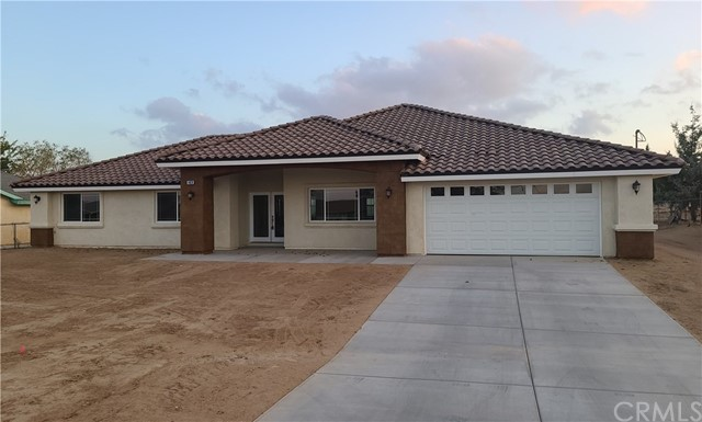 BACK ON  THE MARKET,  SUBJECT TO CANCELLATION OF ESCROW  BRAND NEW CONSTRUCTION HOME BUILT 2020!!BEST PRICE IN THE AREA!! PRIME LOCATION OF HESPERIA!!  THIS BEAUTIFUL HOME FEATURES SPACIOUS 4 BEDROOMS AND 2 BATH. INCLUDES MASTER BEDROOM  WITH WALK IN CLOSET AND  PRIVATE MASTER BATH.  MASTER BATH HAS SEPARATE WALK IN SHOWER, TUB AND  RADIANT DUAL SINKS.   HUGE KITCHEN HAS ELEGANT GRANITE COUNTERTOPS AND WALK -IN PANTRY. PLENTY OF STUNNING CABINETS FOR STORAGE, RECESSED LIGHTING. KITCHEN INCLUDES STAINLESS STEEL STOVE, DISHWASHER, MICROWAVE AND REFRIDGERATOR. GORGEOUS ISLAND STUNNING TILE FLOORING THROUGHOUT KITCHEN AND LIVINGROOM AREAS.  CEILING FANS THROUGHOUT HOME. SO MANY UPGRADES!! VERY NICE  PORCH WITH DOUBLE DOOR ENTRY TO HOME. BACKYARD COMPLETELY FENCED WITH WELL FORMED COVERED PATIO. OVERSIZED GARAGE, LONG DRIVEWAY. HUGE LOT.  THIS HOME IS COMMUTER FRIENDLY, EASY HIGHWAY ACCESS. CLOSE TO SHOPPING AND SCHOOLS DON'T LET THIS ONE PASS YOU BY!!