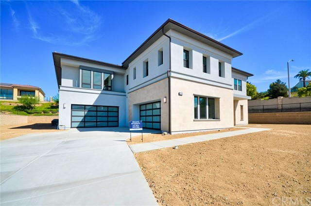 """Brand New Home!!!  This Beautiful Contessa Costal Contemporary model by Toll Brother is situated on a massive lot, over 24,000 square feet, located at the end of a quiet cul-de-sac in prestigious Estancia, Toll Brothers lastest in Yorba Linda. Pool size front yard, 4 car garage, extra large contemporary glass front door, Wood designed tile floor through out the first floor. 1 bedroom guest suite downstairs, Formal dining sitting in the center of dual glass staircase, faces courtyard. Extra Extra large spacious living room with wall to wall sliding glass door opens wide to backyard, bonus room next to kitchen added additional 319 square foot to the original model of 5872, making this house total of 6191 square feet. Gourmet kitchen equipped with craftsman style cabinets upgraded top rated Jenn-air 48"""" range with 6 burner and griddle.  Huge Center island could be breakfast table with extra extra cabinets for those extra plates.  There is also a Secondary wok kitchen. Upgraded Extra long outdoor California room gives so many entertaining options for new home owner.  Upstairs stars at spacious Loft with abundant natural light. Walk in to Master bedroom and you will see the custom designed bathroom, shower, counter top, floor... bedroom size walk-in closet, master bedroom with retreat/office/exercise... and balcony to relax.  This house is waiting for New Home owner to finish the outdoor to complete the dream home.  Top rated schools, NO MELLO-ROOS and low HOA Dues!"""