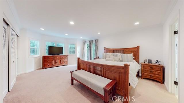 Spacious, sunny primary bedroom.