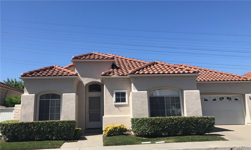 Located in the guard gated Palmia Senior Community. Immaculate single story 2 bedrooms, 2 baths plus a den. Low maintenance yard with a beautiful sunset view. Move in condition.