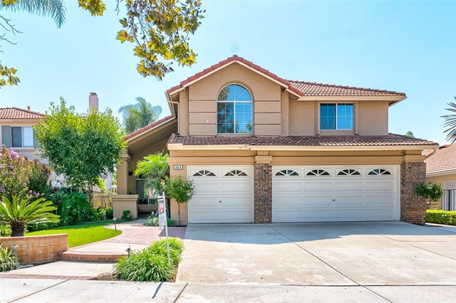 This gorgeous & spacious home, located in the desirable Brea Terrace community, shows like a model & is completely turnkey! This stunning home of approx. 2,600 sq. ft., boasts 5 bedrooms & 3 full bathrooms, with a bright & open floor plan. The kitchen is upgraded, featuring granite countertops, stainless steel appliances, travertine floors & custom-built nook. In addition, there is a breakfast counter, perfect for informal eating. The kitchen opens up to the family room, making it perfect for family gatherings. A formal living & dining room round out the first floor, along with a main floor bedroom & bathroom. All bathrooms are remodeled, complete w/ granite countertops & tile flooring. Make your way up the beautiful oak staircase to your master bedroom retreat, where you will find a spacious master bedroom & full bathroom, complete w/ separate shower & tub & dual sinks. Add'l features include plantation shutters, indoor laundry room and outdoor lighting. The cherry on top is the spectacular backyard, which is an entertainer's delight! A gorgeous tropical retreat awaits you, complete with an in-ground spa, built-in BBQ, firepit, covered patio, palm trees & lush tropical landscaping. You'll never want to leave your very own resort! WON'T LAST! MUST SEE