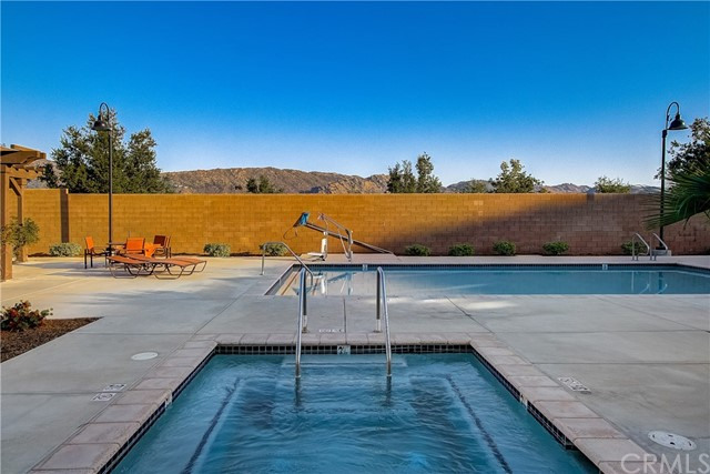 Welcome Home to 6468 Summit Village Lane, Unit 2. These beautiful homes were Built new in 2016 and this home is like new and in pristine condition. Simply move in, unpack and enjoy. FHA approved, pool and spa, hiking, biking. dining and shopping near by with an easy commute to the 405 or 101. The south facing location provides natural sunlight all day long and beautiful second floor views from the primary bedroom. The second floor also provides two additional bedrooms, a full bath, loft space (currently a home gym) and laundry room. Downstairs is California indoor/outdoor living with the large sliding door that completely opens to the front courtyard, a large family room, kitchen with center island, dining area, storage, powder room and spacious two car garage. 6468 Summit Village is an amazing home and a incredible value!
