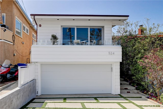 Located on one of the best streets in Manhattan Beach, this four bedroom home has recently undergone an extensive remodel with the highest quality finishes available. The property is unique and extraordinary as it consists of two lots. The main property is 30' x 120' and the sale price includes an additional 30' x 25' parcel to the south east that combined, makes this property special. The fourth bedroom can be used as an extra living room that opens to this amazing backyard with private outdoor living room, fire pit with built in benches, and a YARD!. The quality of the interior remodel must be seen to be appreciated. Additional amenities include Central A/C, high end kitchen, large rear and front deck with nice ocean views, and more. This particular block of 14th Street is one of the most sought after in town as it is quiet, has good parking and is a short walk to downtown MB, American Martyrs school/church, award winning Pacific elementary school, parks and the BEACH!