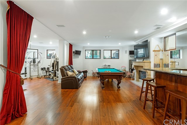 Finished Basement with Bar, Pool Table, Workout Area, Potential 6th Bedroom & Bathroom w/shower plus storage!
