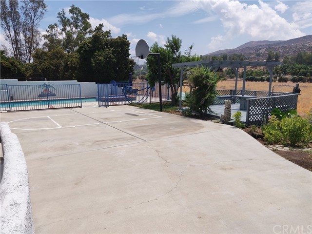 Rear driveway leads to fenced gated pool area