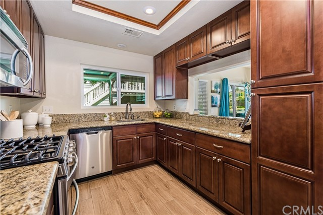 Stainless steel appliances and recessed lighting add a contemporary flair to the kitchen!