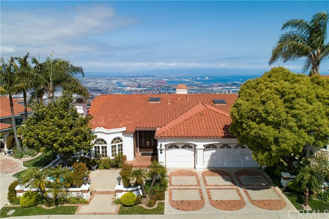 Custom Mediterranean style home located on one of the premier rim lots within the community of Rancho Palos Verdes Estates with panoramic unobstructed views of Catalina, LA Harbor and Downtown LA. Enjoy views from most living areas. This home was previously the model home in the development. Featuring an approx. 3,927 SF living space, 4 BDs, 3.5 BAs and a floorplan that easily flows from the formal living room, dining room, spacious kitchen w/ breakfast nook to the family room. The master suite on the upper level overlooks stunning views and is complete with a master bath w/ jetted tub and separate shower. Kitchen is equipped with stainless steel appliances: 3 ovens, microwave, 2 dishwashers and built in refrigerator. Three additional bedrooms are on the lower level as well as the reading / office area with access to a private patio / sitting area perfect for relaxing and enjoying the views. New hardwood floors and Spanish tile flooring were installed in 2015. Other features include Sonos surround sound throughout, recessed lighting throughout, Spanish style chandeliers in entry, family room + dining room, laundry room, 24-hour guard-attended gate, large storage room + an abundance of storage space, a 3-car garage and additional guest parking spots on the cul-de-sac street. Just a short drive from Trump National Golf Course, Terranea Resort and shopping.