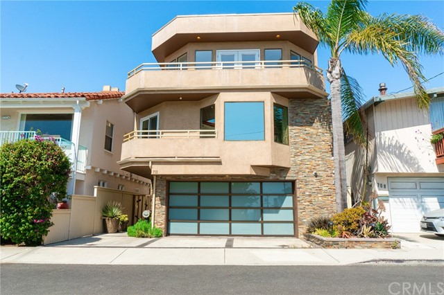This newly updated, primely located ocean-view home sits on a private and premier part of Highland Ave, just a short walking distance from Downtown Manhattan Beach, the Pier, and the ocean itself. This house is the ideal combination of beach living, luxury, class, comfort, and functionality. Panoramic views and natural light illuminate the top floor, perfect for preparing meals in the modern kitchen, gathering in the exquisite dining area, entertaining in the seated bar space, and lounging by the fireplace in the large living room. Double doors lead to a wrap-around balcony, making way for the ocean breeze and fun in the sun. The sizable Master Suite sits on the middle story and is quite a sight, fitted with a fireplace, walk-in closet, lavish Master bathroom, private balcony, and its own ocean and white water views. The home features two additional bedrooms, both with their own spacious closets and bathrooms, and one on the lower level with easy street accessibility. The downstairs also hosts an optimal outdoor seating space, which is hard to find in similar homes in this area. A large two-car garage and additional street spaces provide ample parking accommodations. This home is truly something special. You'll have to see it to believe it!