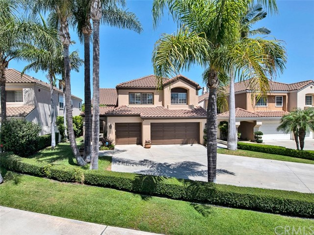 Welcome to 12965 Crawford Drive, a Turn-Key Tustin Ranch Dream Home Located in the Gated Community of Alicante! This Highly Sought-After Interior Location Features Four Bedrooms (One Bedroom and Full Bathroom on the Main Floor), Three Bathrooms, Large Bonus Room, Hardwood Floors, Plantation Shutters, Pool, Spa, New Interior and Exterior Paint, and Natural Light Throughout. The Gourmet Kitchen Enjoys Ample Counter and Cabinet Space, Island with Seating, Double Oven, Built-In Refrigerator, Built-In Wine Fridge, Soft-Closing Drawers/Cabinets, Breakfast Nook, and Overlooks the Backyard. The Family Room Features a Cozy Fireplace, Built-In Cabinets, and Enjoys Backyard Access. The Dining Room Sits Adjacent to the Kitchen and Opens to the Living Room Showcasing a Soaring Ceiling. The Spacious Master Suite Showcases an En-Suite Bath with Makeup Vanity, Walk-In Shower, Separate Tub, and Large Walk-In Closet with Custom Organizers. The Private Entertainer's Backyard Showcases a Built-In BBQ, Pebble Tec Salt Water Pool/Spa, and New Pool Heater. Indoor Laundry Room with Built-In Cabinets. The Large Driveway Leads to a Three Car Garage with Direct Access. Award Winning Tustin Unified Schools. Minutes to Tustin Ranch Golf Course, Tustin/Irvine Marketplace, District Shops, Restaurants, and Hiking/Biking Trails at Peters Canyon Park. Easy Access to 5/55 Freeways and 241/261 Toll Roads. 12965 Crawford Drive is a Must See!