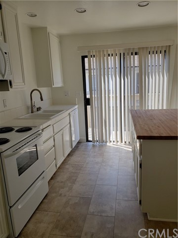 Gourmet Kitchen with a slide going out to the enclosed deck..