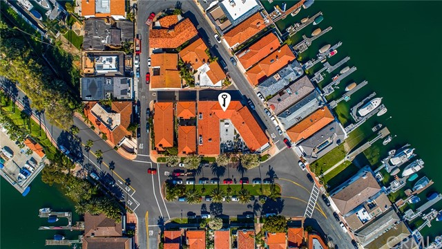 "Generational opportunity to purchase a beautifully remodeled, six-unit condo complex on famed Lido Isle, the adage of location, location, location could not be more accurate when describing this one-of-a-kind investment. Sited an incredible parcel of approximately 3.5 lots and conveniently close to the areas desirable amenities of the bay, world-class dining, Lido Village, shopping and beaches coupled with access to the fabulous amenities of the community of Lido Isle. The six residences each have their own APN and the complex is comprised of four, impeccably and completely rebuilt from floor to ceiling 2-bedroom units that contain interior laundry, AC and top-quality finishes throughout plus two, 3-bedroom units. Each residence offers generous living areas, bedroom spaces, private patios plus enclosed, 2-car garages and range from 1,141 to 1,674sf. Encouraging an indoor/outdoor living environment, a gated, large interior courtyard with seating and bbq areas, welcomes residents, invites relaxation and provides a place in which to unwind and interact. Zoned RM – Residential Multifamily, the property is less than a stone's throw from access to recreation on the bay or an easy jaunt into the Lido Village to enjoy a meal. This offering has the potential for vacation-rental income, long-term stays or even as a family compound. An added benefit is the ""Lido lifestyle"". The community of Lido Isle offers tennis, sailing, beaches, clubhouse and parks as a perk of the HOA."