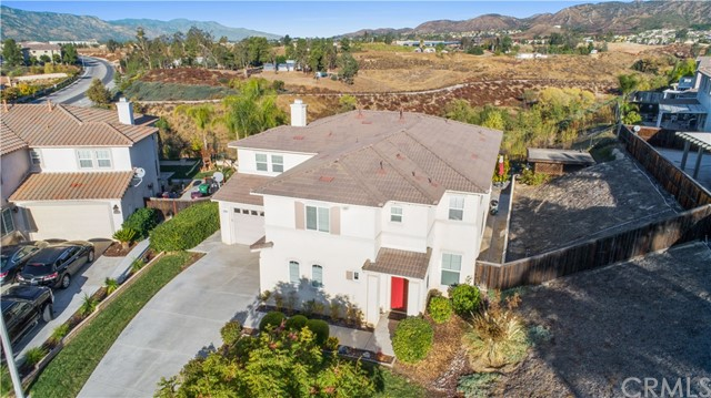 Bring the whole family to this spacious & beautiful central Murrieta home with 6 bedrooms, 4 baths, 3 car garage, located on a large & private lot at the end of on a cul-de-sac with fantastic views!    As you enter the home you are greeted by an elegant round entryway that takes you directly into a large formal living & dining area with gorgeous engineered hardwood flooring, soaring ceilings & an abundance of natural light pouring in.  The gourmet kitchen is open to the eating area & extra-large family room with fireplace so you can entertain to your heart's desire. The gourmet kitchen has everything you will ever need including huge island, built in oven, Viking cooktop, granite sink, reverse osmosis system water filtration & large walk in pantry.  Downstairs there is a large bedroom that has direct access to the single car garage & a full bathroom is right next door. Central vacuum system throughout the home.  Upstairs you will find a small loft, 4 guest bedrooms with walk-in closets in most and one with an en suite bathroom, large laundry room along with a large master suite & deck with forever views.   The backyard has a fantastic views, trickling fountain, is very low maintenance & the houses are spaced far apart with no rear neighbors making it very secluded and private. A lot of extra parking in front of the house unlike most cul-de-sac locations.  Centrally located near shopping, dining, freeways, Old Town Murrieta & Temecula Wine Country.  Low taxes and NO HOA!