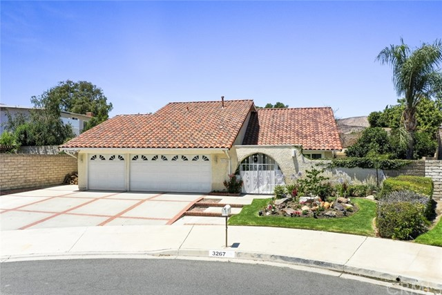 Located in the highly desirable New Monterey Community, this 5 bedroom home offers a tranquil setting of casual elegance, with complete privacy and comfort. This home is in a prime location in a cul-de-sac with only 5 homes. The home is situated on an oversized lot, approximately 8,130 sq. ft. The  2,300 + sq. ft. home features extensive grounds covered with lush landscaping, views of the trees and surrounding hills. A spacious floor plan with a grand entry and vaulted ceiling. The entryway leads into the open living room and dining room. The cozy den has beamed ceilings, French doors leading to outside patio, along with a full stone fireplace leading to the kitchen. The open kitchen comes with Stone Leather Granite kitchen countertops and includes a walk-in pantry!  The kitchen and den are truly the heart of the home, and the ideal gathering place. A downstairs 5th bedroom can also be used as an office or work out room! In addition, home has a full spacious main floor guest bathroom which completes the main level. The second floor features a large Master bedroom, restroom shower & vanity and a large walk-in closet! Three additional bedrooms with one full restroom plus a bathtub completes the second floor. The lovely courtyard provides privacy with a secluded atmosphere. The backyard garden features a beautiful grassy lawn landscaping, fruit trees, flow