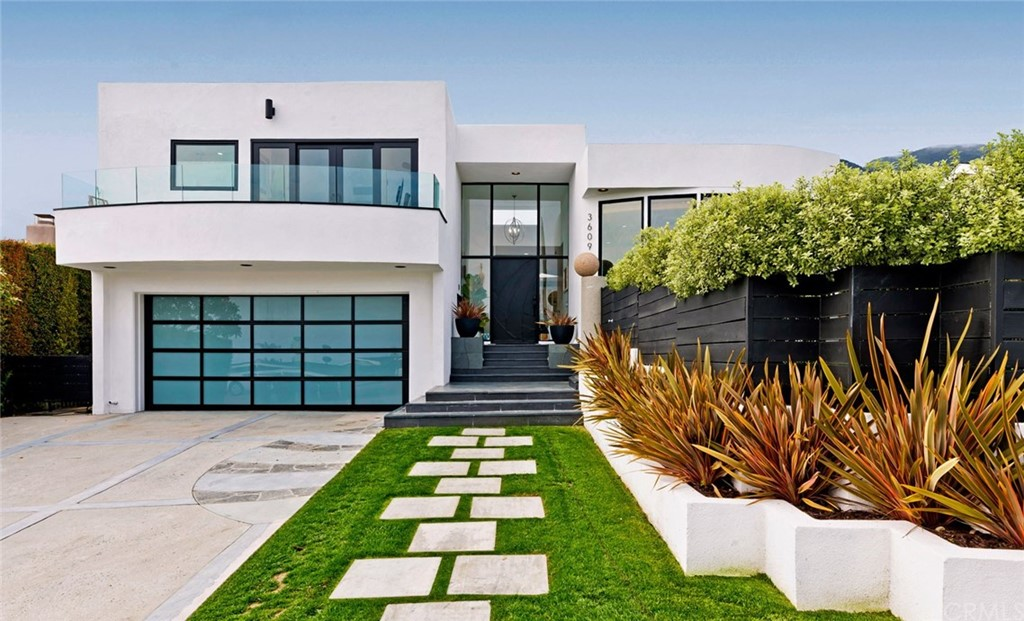 Contemporary Malibu remodeled home with forever ocean & city views.   Located in Sunset Mesa neighborhood near The Getty Villa.  Enter the home mid level with soaring ceiling through the entry to an open concept living/dining room, family room and kitchen.  Access  from family room to the lushly landscaped private yard with patio and path that wraps around to the front private gated yard.   Beautiful light and airy split level floor plan with three spacious bedrooms upstairs, two baths, while enjoying your ocean views from master suite, walk out deck & bath.  The master suite features a walk-in cedar lined closet with organizers.  The lower level has two spacious bedrooms and one full bath, or a one bedroom and a office/bedroom.  This home can be 4 bedroom, plus and office or 5 bedroom home.  One of the lower bedrooms has access to the back yard.  Minutes away from infamous Malibu beaches, The Getty Villa, Palisades Village, Pepperdine University and the Santa Monica Mountain hiking trails, restaurants and shopping on famed Montana Ave..  This home will certainly exceed your expectations!