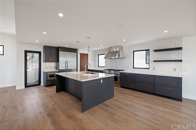 Central kitchen with functional layout and designer flavor leads to spectacular roof top deck