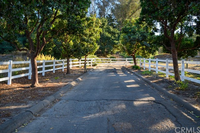 "Rare opportunity to own 15.13 acres 8 min. from the Village of Arroyo Grande & 15 min to Pismo Beach! Would make a fabulous family compound w/currently 2 residences + caretaker's apt. w/the ability to put on 2 more residences. Horse facilities like no other! Ride in the 220 X 100 outdoor arena or when it's raining use the 140 X 90 indoor arena. Round pen.The breezeway barn features 16 stalls w/large runs includes automatic waters & feeders. The huge tack room can hold enough tack for all your horses' needs. A storage area for storing farm equipment. Attached 1 bedroom /1 bath apartment in the large barn offers a LR w/a kitchenette area. Above the barn a 1600 sq.ft. storage & feed loft. This horse facility has great income potential! The home on 5 acres is a 2008 manufactured home w/3BD/3BA,vaulted ceilings & wood laminate flooring.Spacious kitchen w/pantry, large master, indoor laundry.This residence sits at 1200 sq.ft.allowing another residence. The 10 acres has a 3BR/2BA home, 2200 sq.ft. w/vaulted ceilings, open concept, large kitchen w/island, maple cabinets, quartz counter tops. Separate living room & fireplace in the family room. Currently used for short term rental. Several pads for building a secondary dwelling, barn or shop. Several fenced pastures for your horses. Come enjoy the beauty & serenity of the Oak studded hillsides, surrounded by your equine companions, while just a short drive to the charming ""Village"" of Arroyo Grande and the equestrian-friendly beaches."