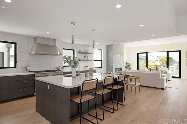 Tastefully appointed modern kitchen opens to living space and extends to the spacious balcony (shown here using reverse of 961 Unit A staging)
