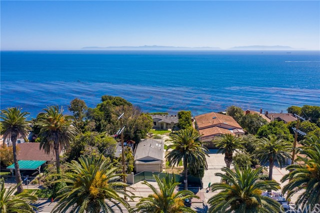 **SAVE MONEY AND TIME (See further below) **UNOBSTRUCTABLE OCEAN VIEWS** How about having the Pacific Ocean for your backyard? We're not talking just ocean views, but a property that has actual ocean FRONTAGE! Encompassing almost 20,000 sq feet, this oceanfront, bluff-top, mostly flat lot, is truly a rare opportunity. Why remodel when you can tear down current existing structures and start from scratch? Design that gorgeous dream oceanfront home you have always wanted. Enjoy peaceful ocean and Catalina views and sailboats gliding by. Whale watch from the comfort of your own home since the ocean is literally your backyard!Incredible opportunity with this particular property.Unlike other lots which have a sheer cliff, this property's slope has been transformed into a meandering path toward the ocean with un-permitted multi-level tiers. WHY NOT SAVE MONEY AND TIME? All properties along the bluff in the area require city as well as Coastal Commission review and approval IF you're looking to add square footage or build. You may be able to SAVE tens of thousands of dollars and leverage the reports the seller has conducted already. Currently property has 2 structures, a guest house studio with attached garage and a shell frame of a house. Both are considered tear downs and property is sold AS-IS. It's a blank canvas ready to be transformed into your ocean view masterpiece. Contact your agent to get more details today.
