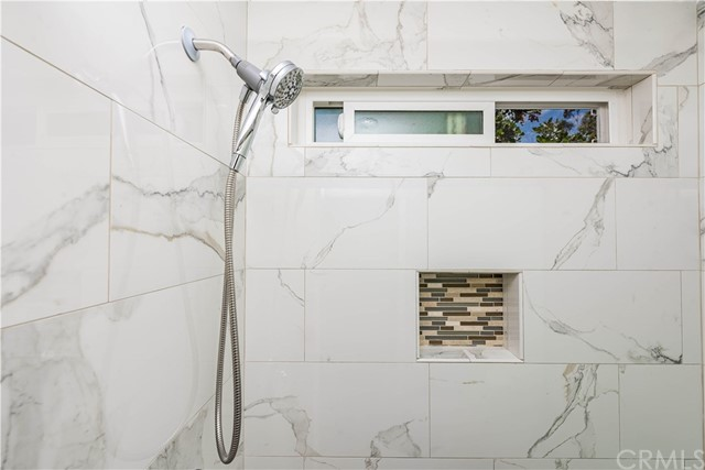 The newer marble style shower surround with built-in space for all your shower needs!