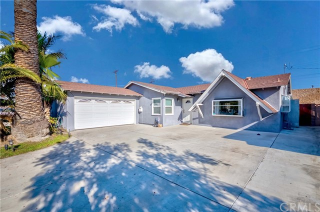 Gorgeous Remodeled Single Level Home in the High in Demand City of Westminster! You will fall in love with the stunning curb appeal of this craftsman style home with gable accent roof. Home is nestled behind your large driveway w/ample parking, great floor plan w/3 bedrooms, 1.5 bathrooms & huge Bonus Permitted enclosed patio room! Formal living room open up to formal dining space w/Sliding door access to your huge bonus enclosed patio room. Bonus room flows w/the overall concept of the home and is currently being used as a family room/entertainment space large enough for a bar, dining, game room & more! (Bonus enclosed patio room is permitted, it is not inc. on MLS Sq Ft. If included home is Appx. 1,620 Sq. Ft.)  Newly remodeled elegant galley kitchen w/granite countertop, custom cabinets & stainless steel appliances, kitchen opens up to dining nook. All 3 bedrooms are abundant in size & share 1 large hallway bath, plus another 1/2 bath for guests. Backyard is an entertainer's delight w/custom built deck, lush grass, and plenty of space to host all your family & friends! Two car garage w/lots of space for extra storage. On top of it all, elegant wood flooring sweeps throughout, recently painted interior with designer selected color tones, smoothed ceilings, crown molding & more! Centrally located near schools, shopping, parks, grocery stores, dining, entertainment & easy freeway commute! Don't miss the Once in a Lifetime Opportunity to call this HOME. This one will not last!
