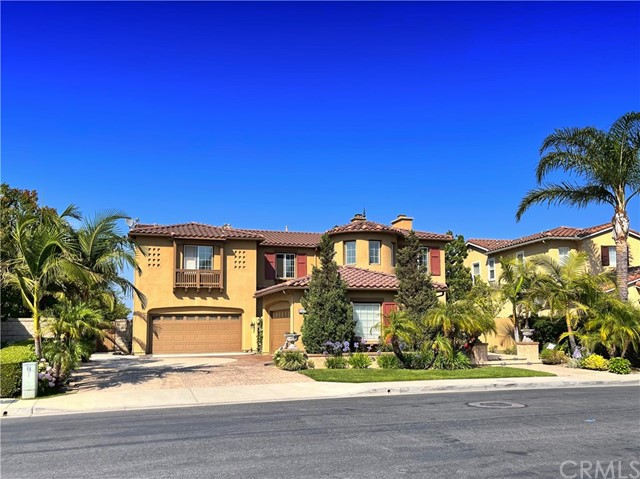 This property has unbelievable panoramic views from the Summit and features courtyard entry, upgraded flooring , custom wrought iron work. Formal dining room and reception area. Main bedroom has a suite, fireplace, double walk in closet, balcony access to the views dual sinks, make-up area, separate tub and shower. Kitchen features custom cabinets, granite countertops.  Has a private office downstairs as well as built-in desk upstairs. Features a full bedroom downstairs with its own bathroom. Located inside a guard gated community.